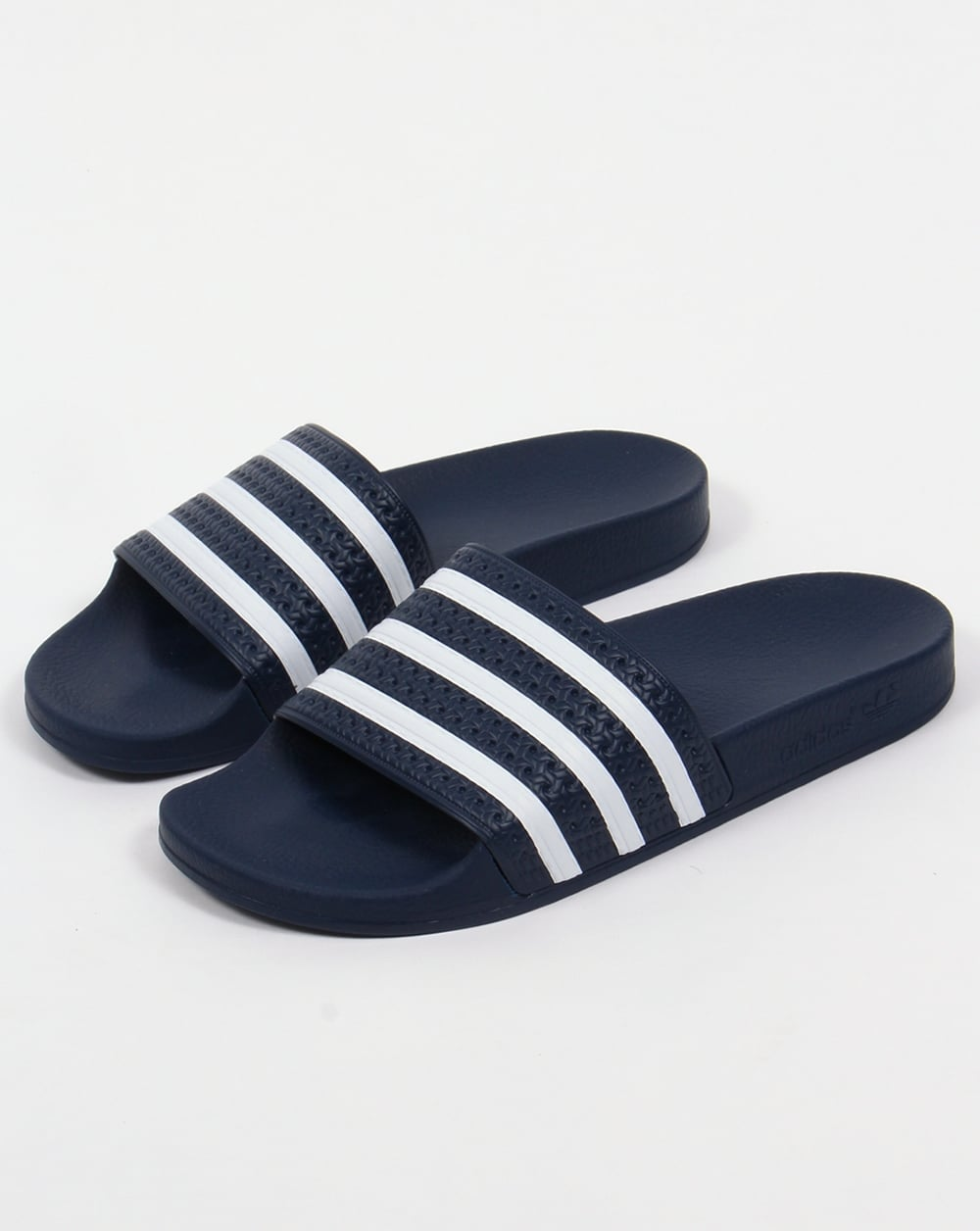 3120c0e0c372 adidas adilette slides. Above  The adidas adilette slides in navy white now  available at 80s Casual Classics.