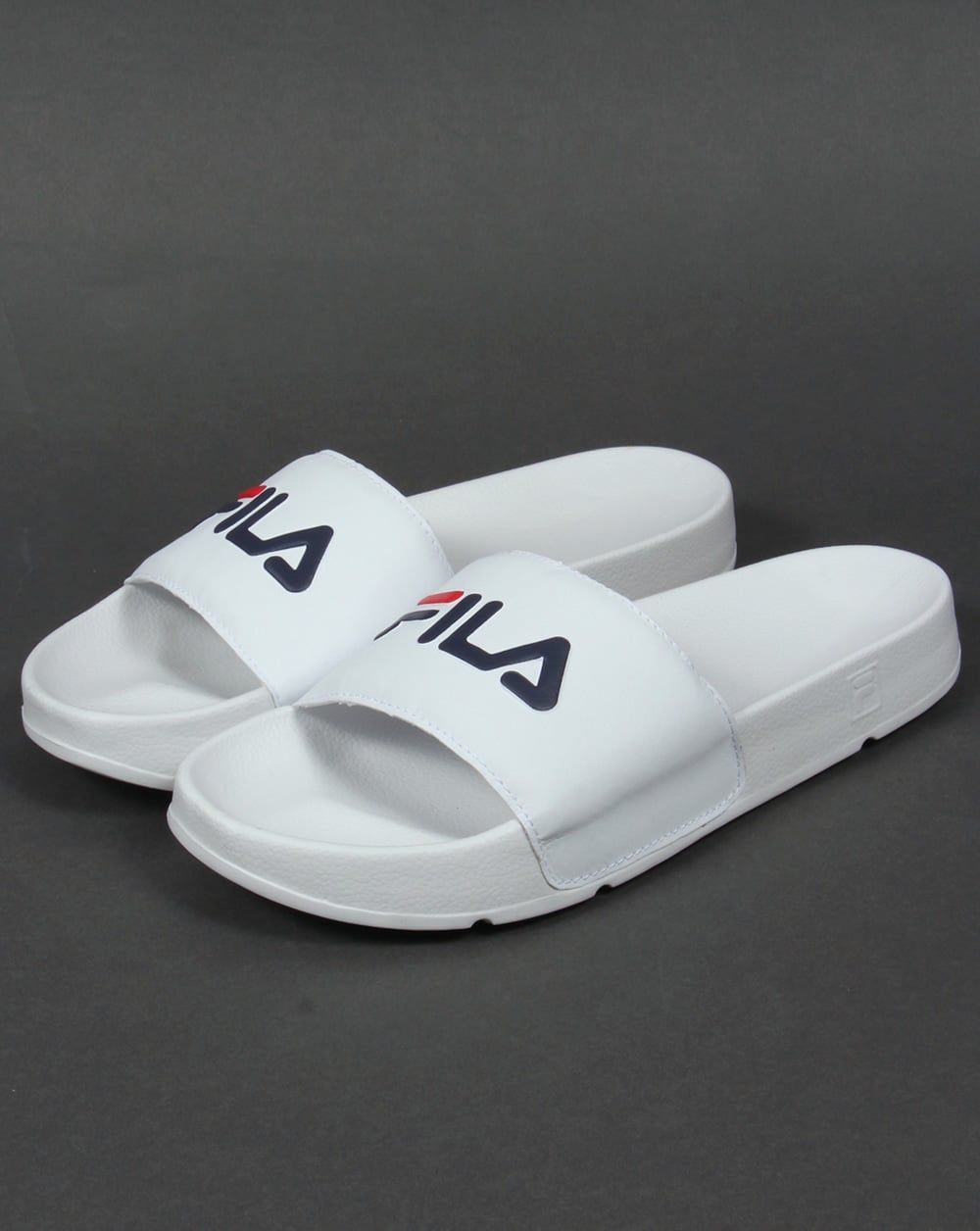 bff174084d71 Slip Into These Summer Slides With 80s Casual Classics - 80 s Casual ...