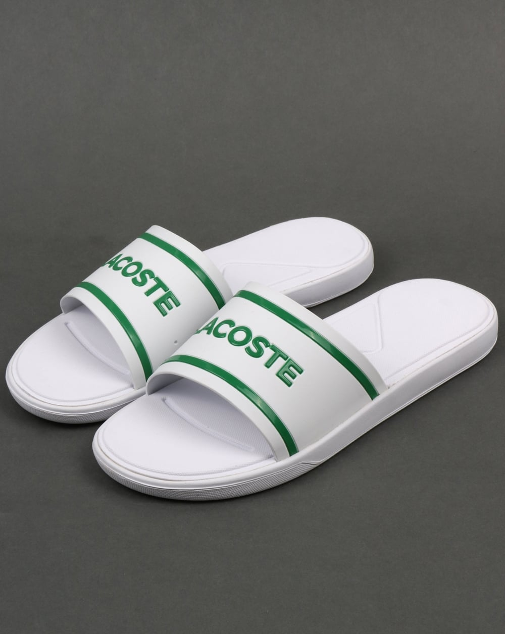 e8a9cd431b6c Above  The Lacoste slides in white green now available at 80s Casual  Classics.