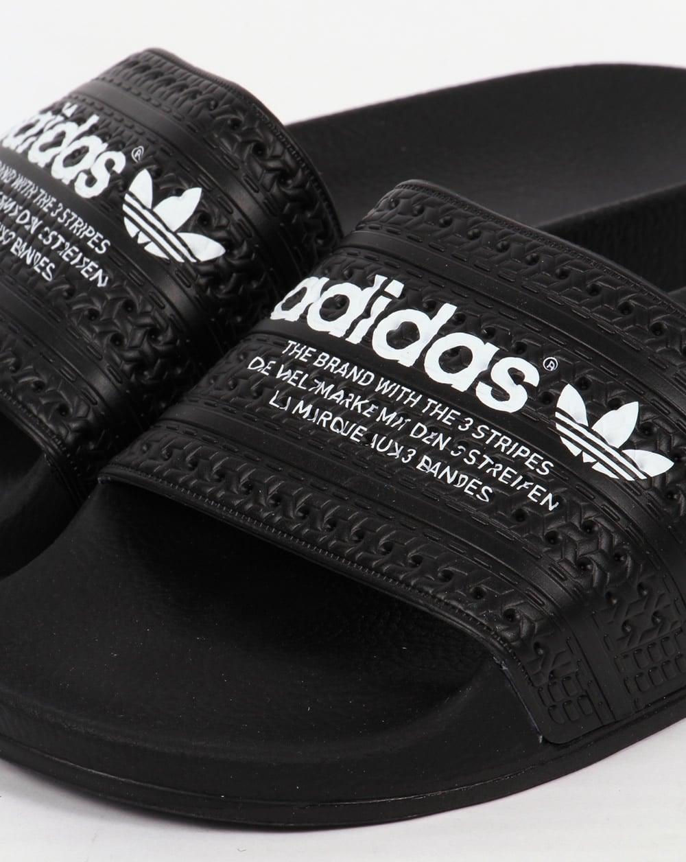 best loved 4b6c5 af063 Adidas Adilette Sliders Black