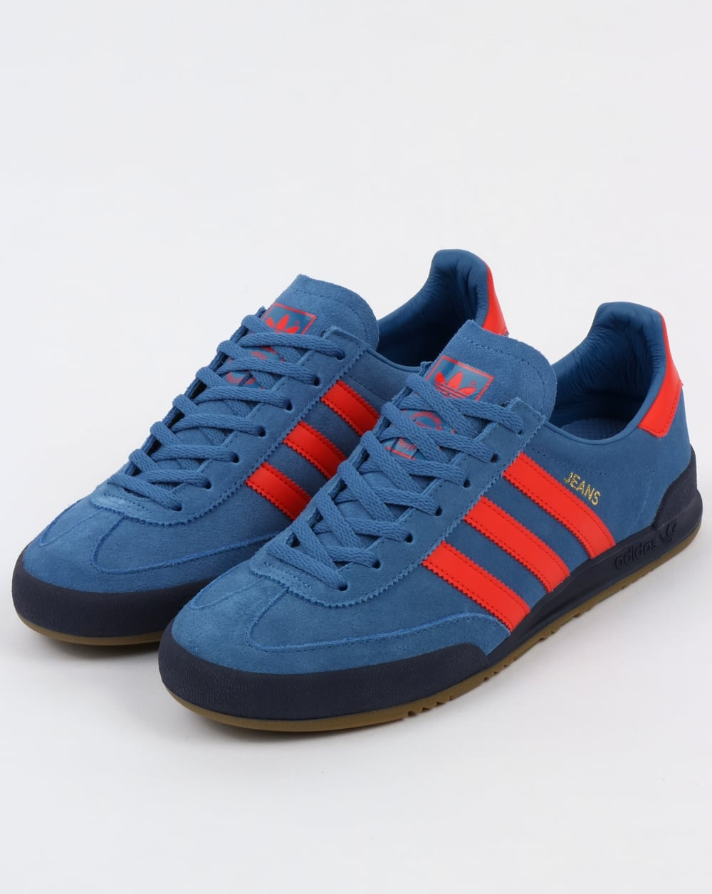 red and blue adidas trainers