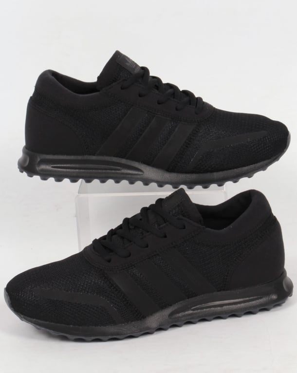 triple black adidas trainers