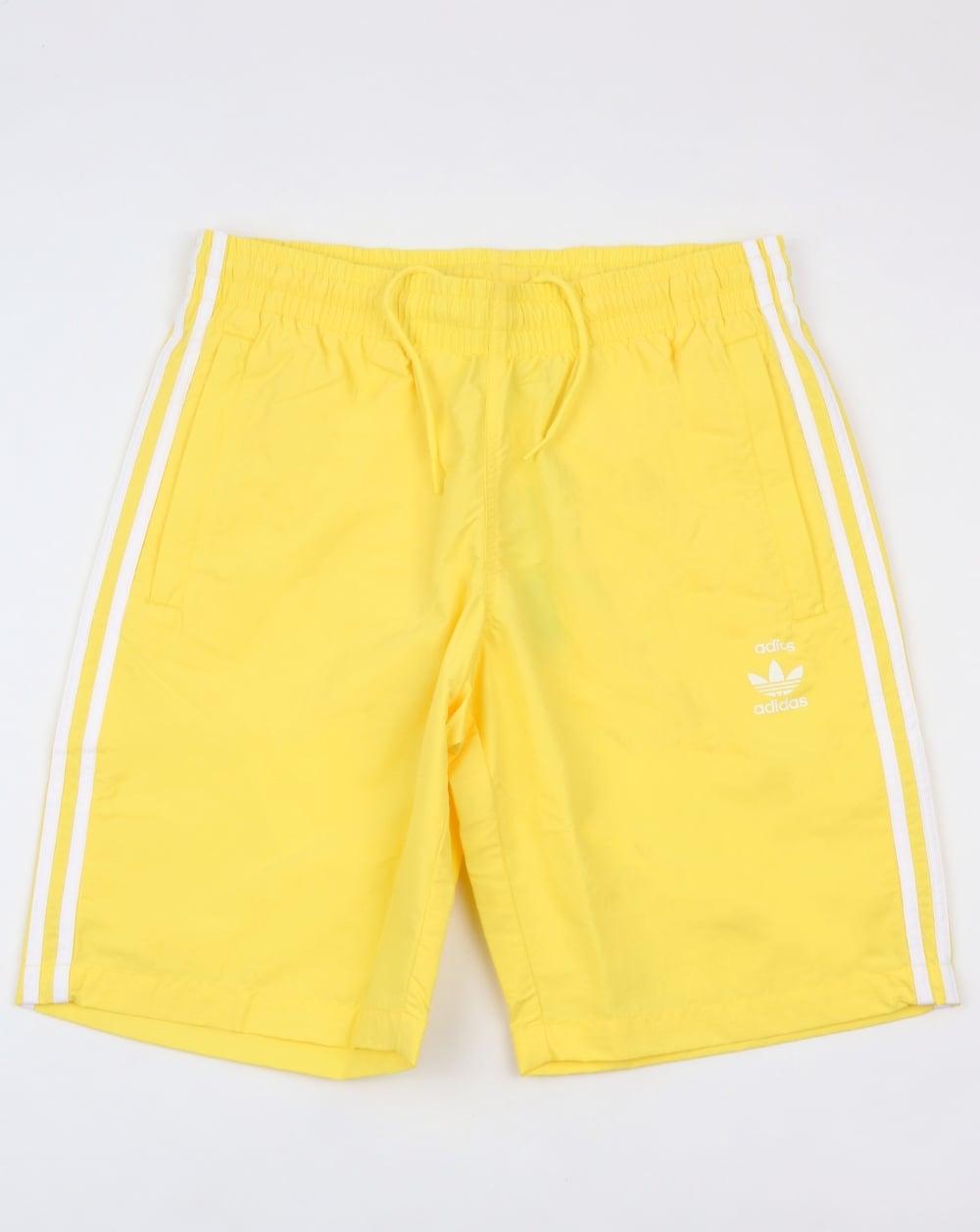 d7bc6c06d0971 adidas Originals Adidas Originals 3 Stripes Swim Shorts Intense Lemon