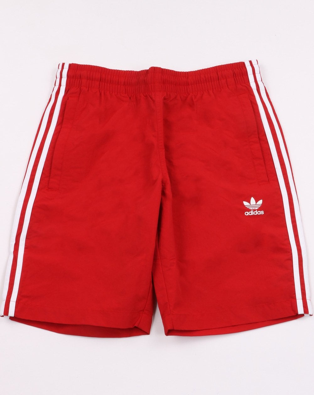 5365a8a3e2 Adidas Originals 3 Stripes Swim Shorts Power Red | 80s casual classics