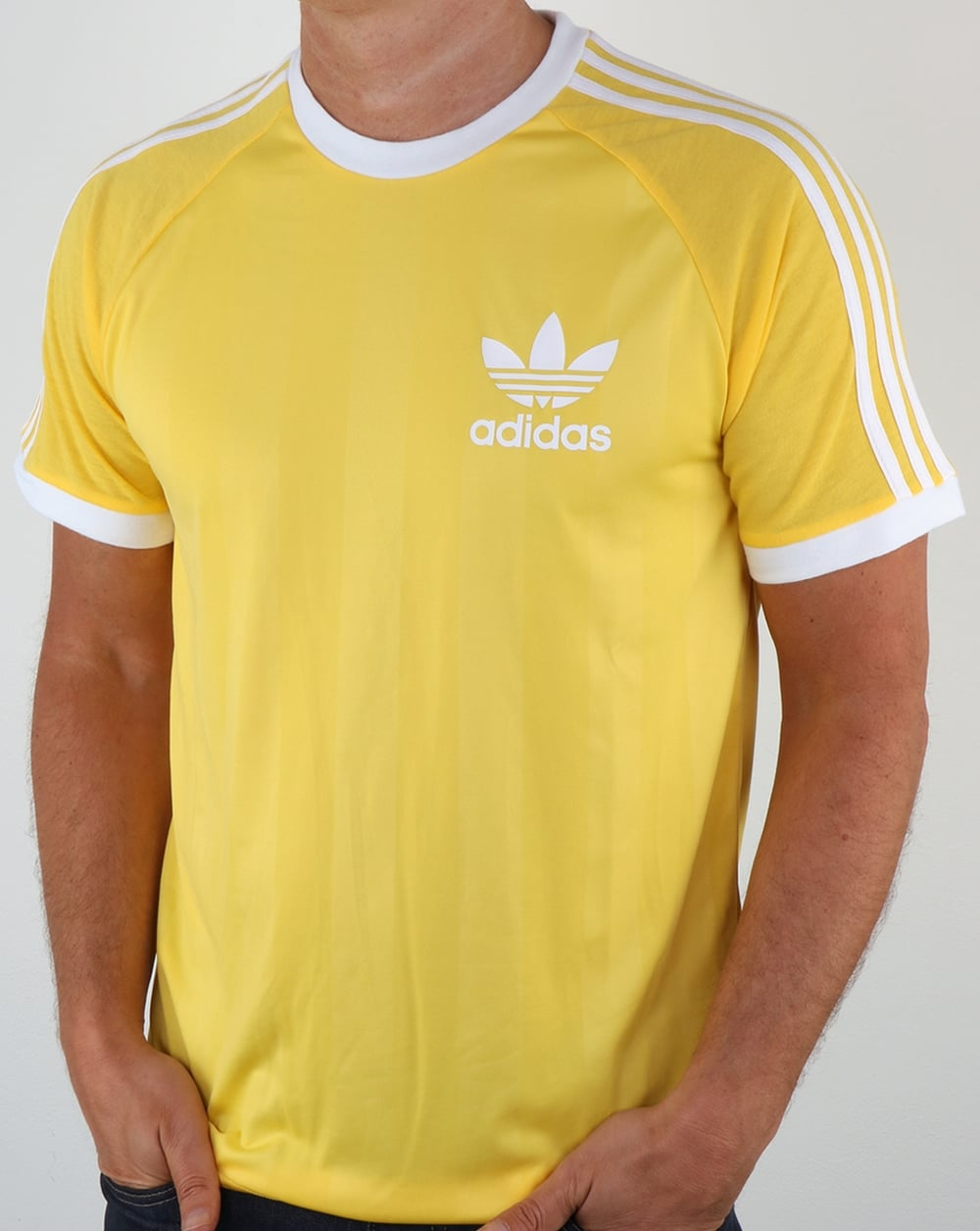 white adidas trainers with green stripes shirt