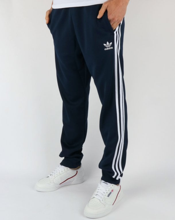 super popular watch shades of Adidas Originals Superstar Track Pants Navy/White ...