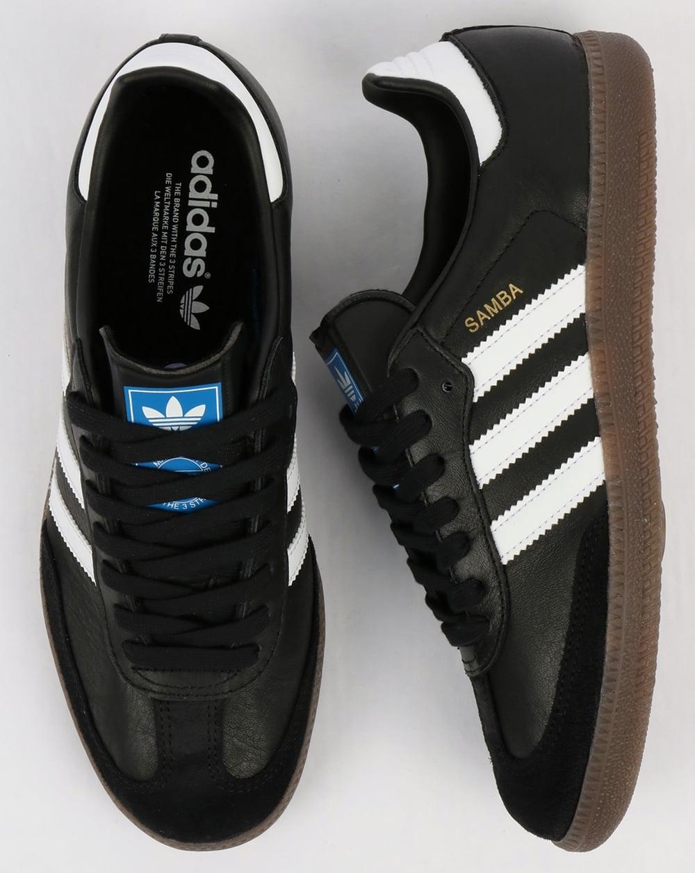 black and white adidas samba trainers
