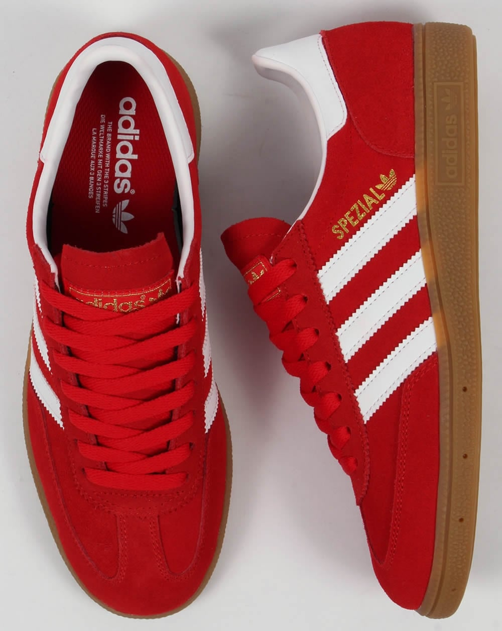red and white adidas trainers