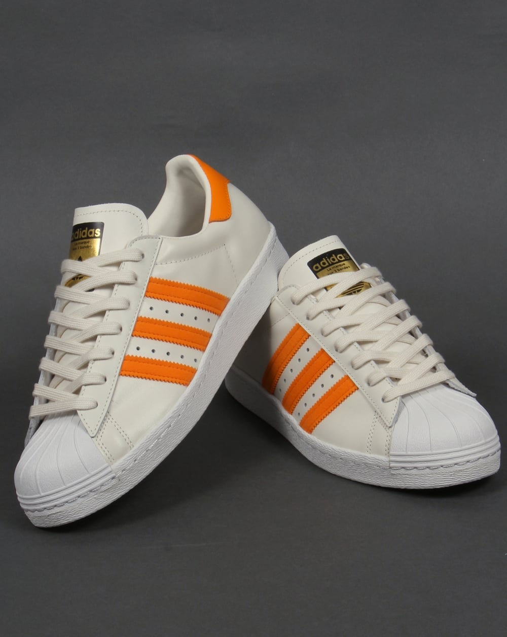 finest selection fc170 d6f7f Adidas Superstar 80s Trainers Off White Orange