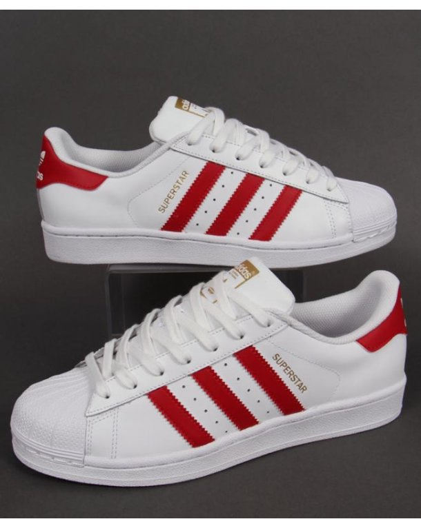 white and red adidas trainers