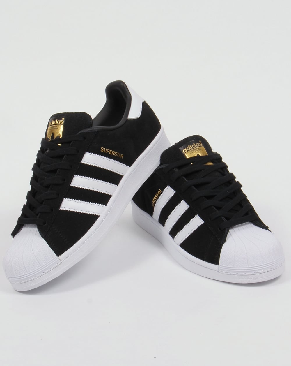 black adidas superstar trainers