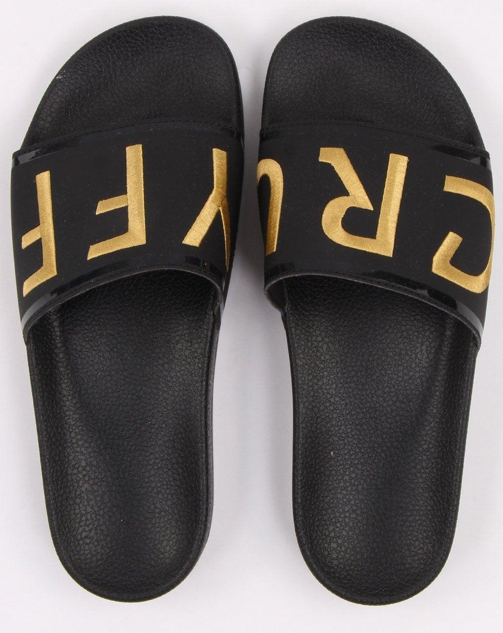 627558c5bca Cruyff Copa Sliders in Black and Gold
