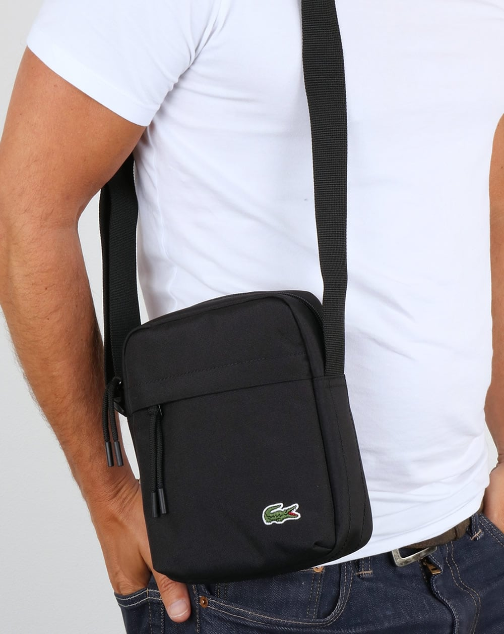 94b13bc655b Lacoste Vertical Camera Bag Black | 80s casual classics