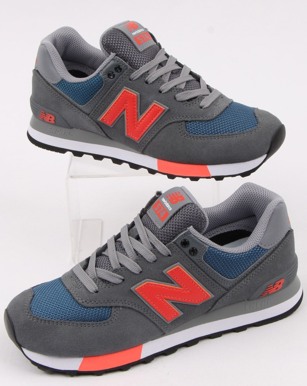wholesale dealer aa689 a1c30 New Balance 574 Trainers Grey/Orange