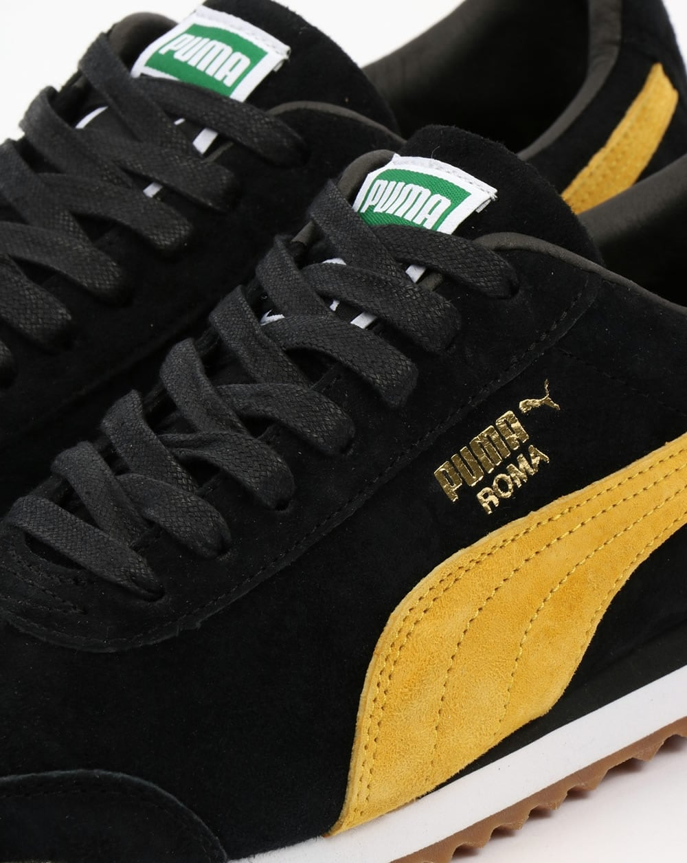black and yellow puma shoes