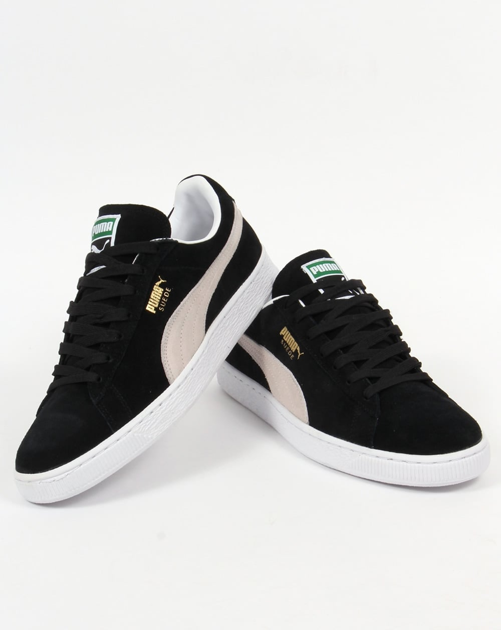 black and white pumas suede