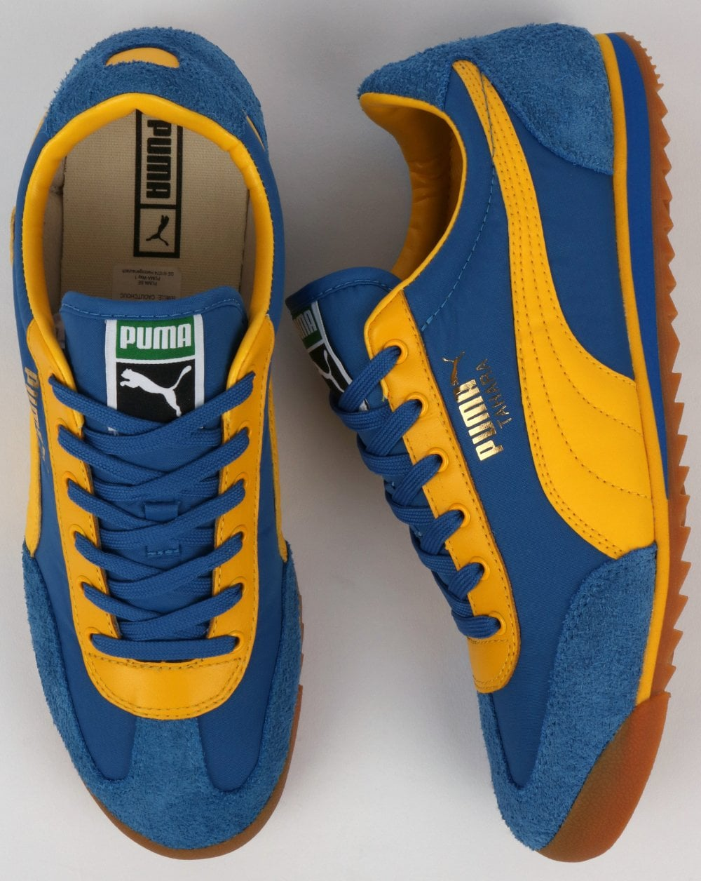 navy blue and yellow pumas off 66% - he