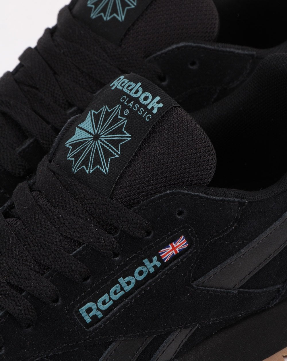 6617b844a295 Reebok Classic Leather Trainers in Black Mineral Mist