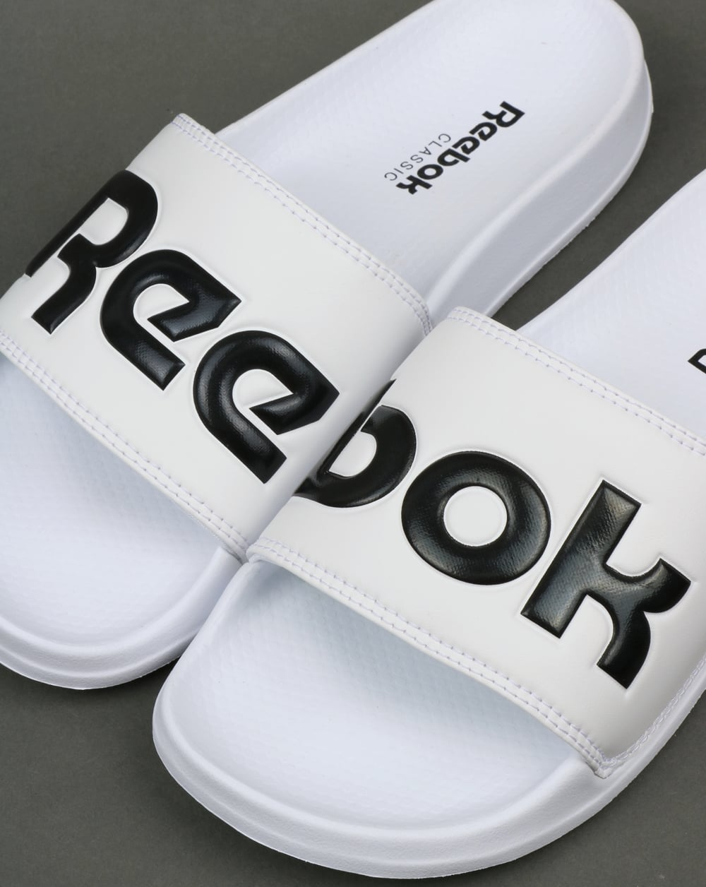 655a2a5489f36d Reebok Classic Logo Sliders White